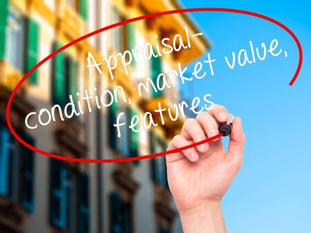 evaluated: Man Hand writing Appraisal - condition, market value, features, with black marker on visual screen. Isolated on city. Business, technology, internet concept. Stock Image