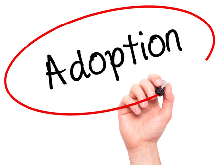 daughter in law: Man Hand writing Adoption with black marker on visual screen. Isolated on white. Business, technology, internet concept.
