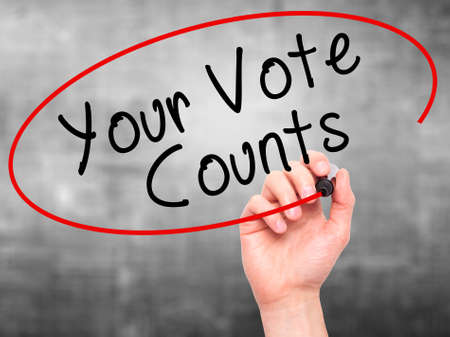 counts: Man Hand writing Your Vote Counts with black marker on visual screen. Isolated on grey. Business, technology, internet concept. Stock Image