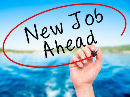 unemployment: Man Hand writing New Job Ahead with black marker on visual screen. Isolated on nature. Business, technology, internet concept. Stock Image