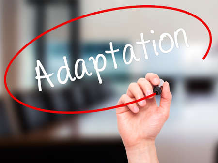 adaptation: Man Hand writing  Adaptation  with black marker on visual screen. Isolated on background. Business, technology, internet concept. Stock Photo Stock Photo