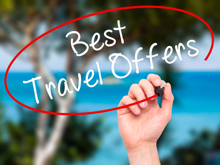 best travel destinations: Man Hand writing Best Travel Offers  with black marker on visual screen. Isolated on nature. Travel technology, internet concept. Stock Image