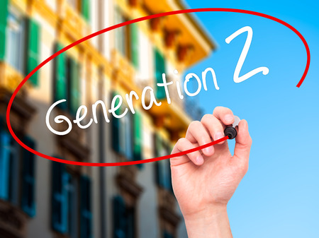 generation: Man Hand writing Generation Z with black marker on visual screen. Isolated on city. Business, technology, internet concept. Stock Image Stock Photo