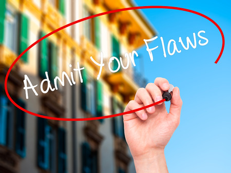 admit: Man Hand writing Admit Your Flaws with black marker on visual screen. Isolated on background. Business, technology, internet concept. Stock Photo