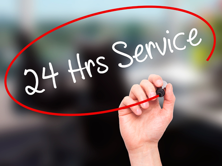 hrs: Man Hand writing 24 Hrs Service with black marker on visual screen. Isolated on background. Business, technology, internet concept. Stock Photo