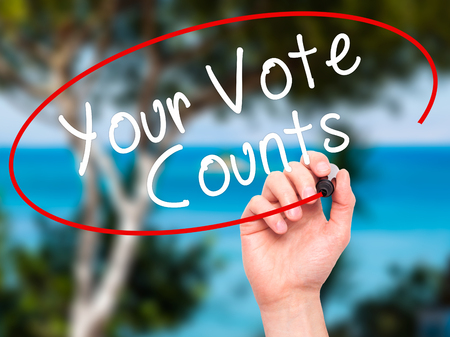 counts: Man Hand writing Your Vote Counts with black marker on visual screen. Isolated on nature. Business, technology, internet concept. Stock Image