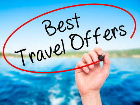 brazilian caribbean: Man Hand writing Best Travel Offers  with black marker on visual screen. Isolated on nature. Travel technology, internet concept. Stock Image
