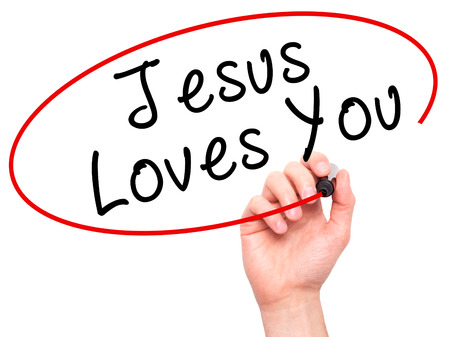 testament schreiben: Man Hand writing Jesus Loves You with black marker on visual screen. Isolated on white. Religion, technology, internet concept. Stock Image