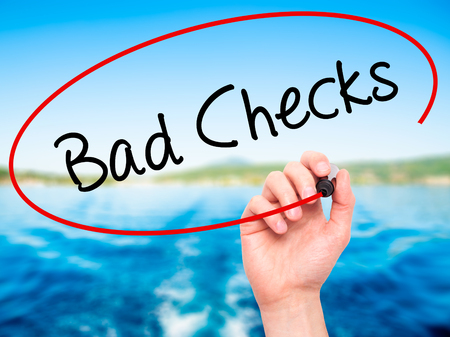 checkbook: Man Hand writing Bad Checks with black marker on visual screen. Isolated on background. Business, technology, internet concept. Stock Photo Stock Photo