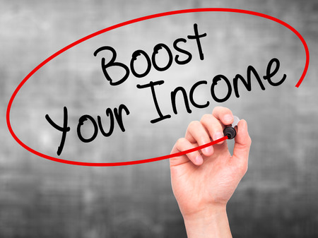 emolument: Man Hand writing Boost Your Income with black marker on visual screen. Isolated on grey. Business, technology, internet concept. Stock Photo