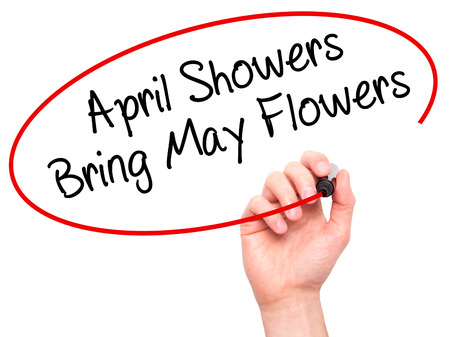 april showers: Man Hand writing April Showers Bring May Flowers with black marker on visual screen. Isolated on white. Business, technology, internet concept. Stock Photo