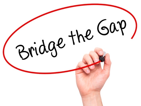 bridging the gaps: Man Hand writing Bridge the Gap with black marker on visual screen. Isolated on white. Business, technology, internet concept. Stock Photo Stock Photo