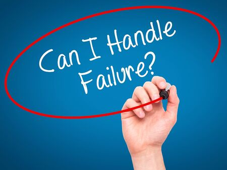loss leader: Man Hand writing Can I Handle Failure? with black marker on visual screen. Isolated on blue. Business, technology, internet concept. Stock Photo Stock Photo