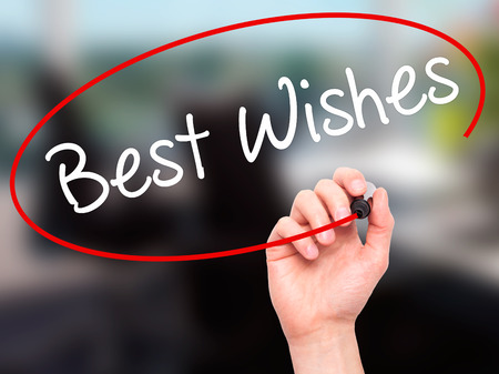 farewell party: Man Hand writing Best Wishes  with black marker on visual screen. Isolated on office. Business, technology, internet concept. Stock Photo