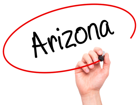 stone of destiny: Man Hand writing  Arizona  with black marker on visual screen. Isolated on background. Business, technology, internet concept. Stock Photo