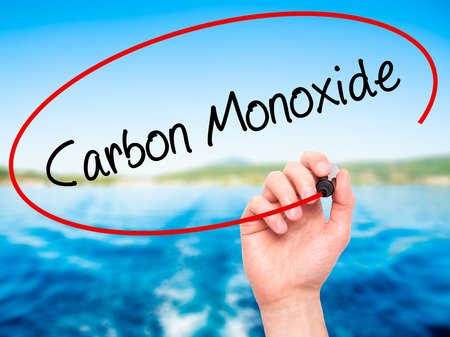 vapour: Man Hand writing Carbon Monoxide  with black marker on visual screen. Isolated on nature. Business, technology, internet concept. Stock Photo Stock Photo