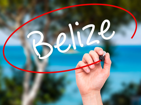 tourism in belize: Man Hand writing Belize with black marker on visual screen. Isolated on nature. Business, technology, internet concept. Stock Photo