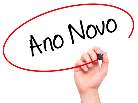 "january 1: Man Hand writing ""Ano Novo"" (In Portuguese: New Year) with black marker on visual screen. Isolated on white. Business, technology, internet concept. Stock Photo"