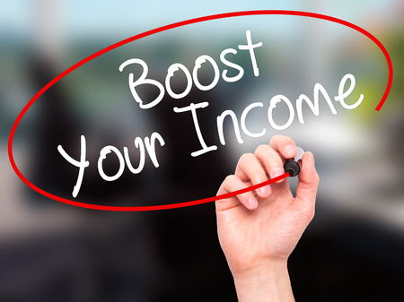 takings: Man Hand writing Boost Your Income with black marker on visual screen. Isolated on office. Business, technology, internet concept. Stock Photo