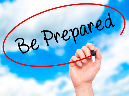 be prepared: Man Hand writing Be Prepared with black marker on visual screen. Isolated on sky. Business, technology, internet concept. Stock Photo Stock Photo