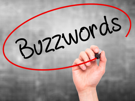convey: Man Hand writing Buzzwords with black marker on visual screen. Isolated on background. Business, technology, internet concept. Stock Photo Stock Photo