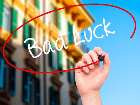 black luck: Man Hand writing Bad Luck with black marker on visual screen. Isolated on background. Business, technology, internet concept. Stock Photo