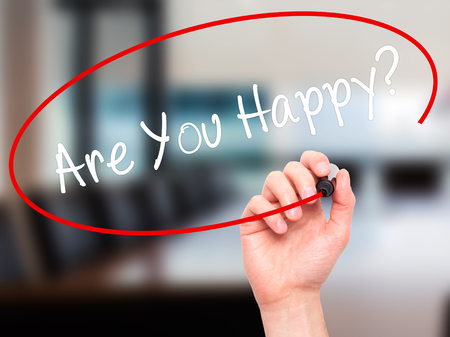 properous: Man Hand writing Are You Happy? with black marker on visual screen. Isolated on office. Business, technology, internet concept. Stock Photo