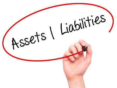 liabilities: Man Hand writing Assets Liabilities with black marker on visual screen. Isolated on white. Business, technology, internet concept. Stock Photo Stock Photo