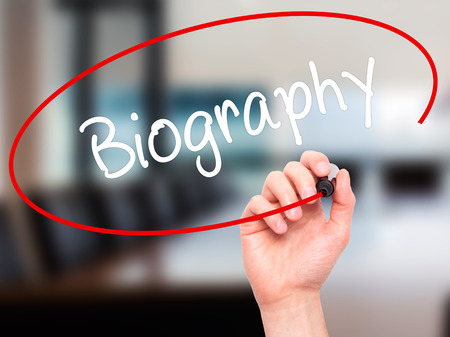 memoir: Man Hand writing Biography  with black marker on visual screen. Isolated on office. Business, technology, internet concept. Stock Photo