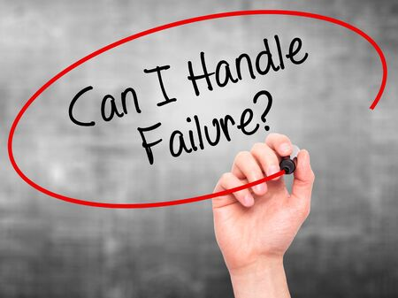 loss leader: Man Hand writing Can I Handle Failure? with black marker on visual screen. Isolated on grey. Business, technology, internet concept. Stock Photo