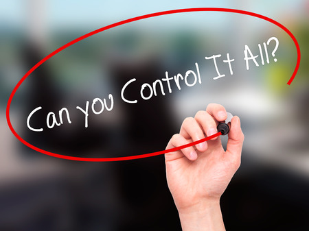 multitask: Man Hand writing   Can you Control It All? with black marker on visual screen. Isolated on office. Business, technology, internet concept. Stock Photo