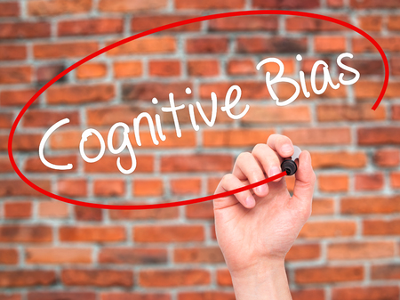 cognitive: Man Hand writing Cognitive Bias with black marker on visual screen. Isolated on background. Business, technology, internet concept. Stock Photo