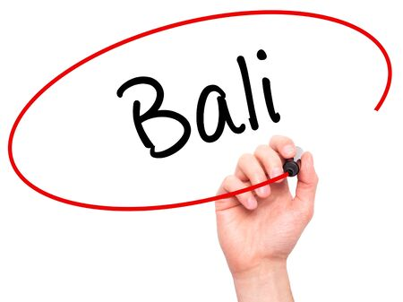 bali province: Man Hand writing Bali  with black marker on visual screen. Isolated on white. Business, technology, internet concept. Stock Photo