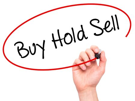 press agent: Man Hand writing  Buy Hold Sell with black marker on visual screen. Isolated on white. Business, technology, internet concept. Stock Photo