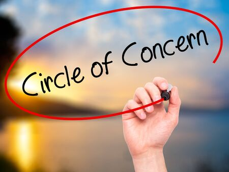 business concern: Man Hand writing Circle of Concern with black marker on visual screen. Isolated on background. Business, technology, internet concept. Stock Photo