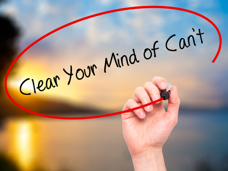 cant: Man Hand writing Clear Your Mind of Cant with black marker on visual screen. Isolated on nature. Business, technology, internet concept. Stock Photo Stock Photo