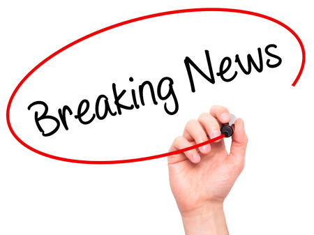 annoucement: Man Hand writing Breaking News with black marker on visual screen. Isolated on white. Business, technology, internet concept. Stock Photo