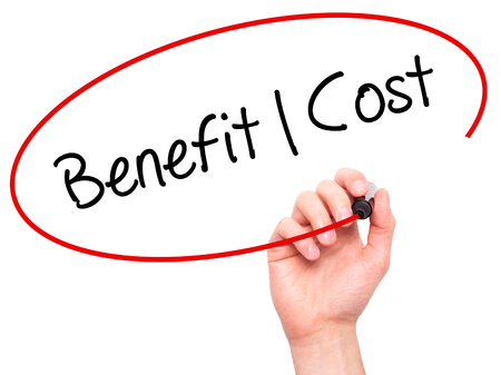 benefit: Man Hand writing Benefit Cost with black marker on visual screen. Isolated on white. Business, technology, internet concept. Stock Photo