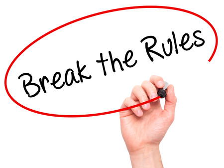 Man Hand writing Break the Rules with black marker on visual screen. Isolated on white. Business, technology, internet concept. Stock Photo Stock Photo
