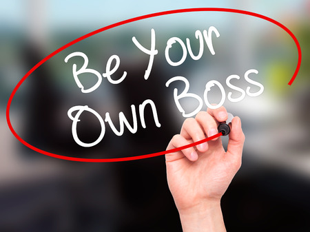 self starter: Man Hand writing Be Your Own Boss with black marker on visual screen. Isolated on office. Business, technology, internet concept. Stock Image Stock Photo