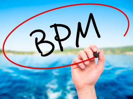 bpm: Man Hand writing  BPM (Business Process Management) with black marker on visual screen. Isolated on background. Business, technology, internet concept. Stock Photo