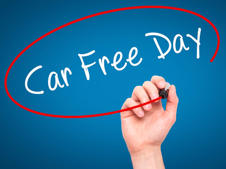 polution: Man Hand writing Car Free Day with black marker on visual screen. Isolated on background. Business, technology, internet concept. Stock Photo Stock Photo