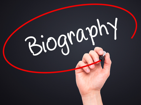 memoir: Man Hand writing Biography  with black marker on visual screen. Isolated on black. Business, technology, internet concept. Stock Photo Stock Photo