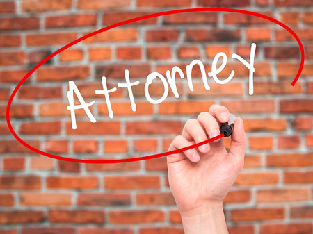 deeds: Man Hand writing Attorney  with black marker on visual screen. Isolated on bricks. Business, technology, internet concept. Stock Photo