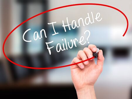 loss leader: Man Hand writing Can I Handle Failure? with black marker on visual screen. Isolated on office. Business, technology, internet concept. Stock Photo Stock Photo