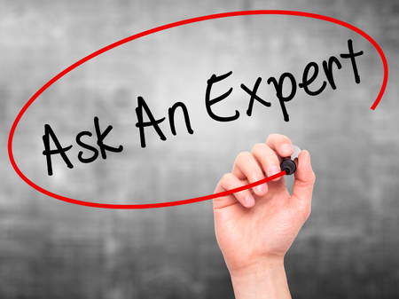 warranty questions: Man Hand writing Ask An Expert with black marker on visual screen. Isolated on grey. Business, technology, internet concept. Stock Photo Stock Photo