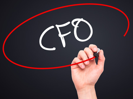 cfo: Man Hand writing CFO (Chief Financial Officer) with black marker on visual screen. Isolated on background. Business, technology, internet concept. Stock Photo