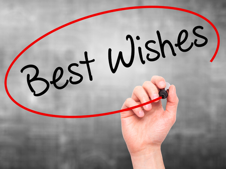 farewell party: Man Hand writing Best Wishes  with black marker on visual screen. Isolated on grey. Business, technology, internet concept. Stock Photo