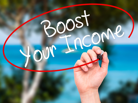 takings: Man Hand writing Boost Your Income with black marker on visual screen. Isolated on nature. Business, technology, internet concept. Stock Photo Stock Photo