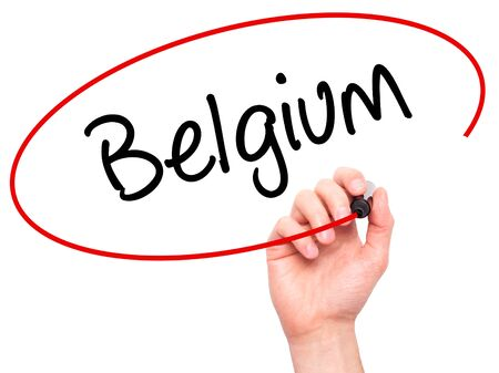 Man Hand writing Belgium  with black marker on visual screen. Isolated on background. Business, technology, internet concept. Stock Photo